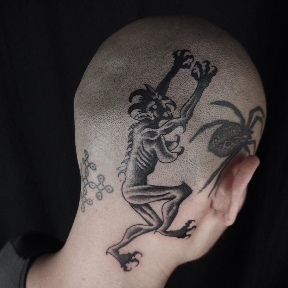 Back-of-Head-Tattoo-by-Rafel-Delalande.jpg