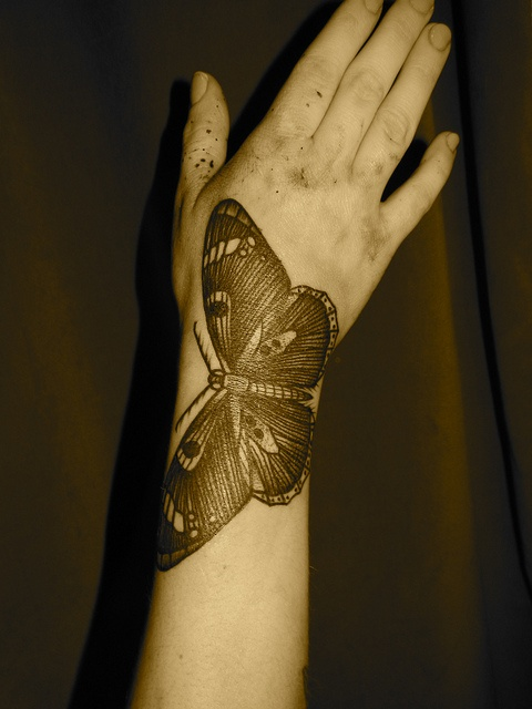 liam-sparkes-tattoo-butterfly-on-arm-and-hand.jpg