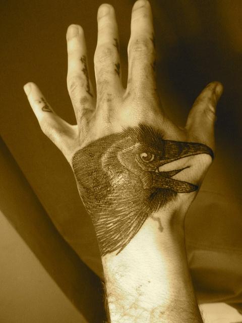 liam-sparkes-tattoo-crow-on-hand.jpg