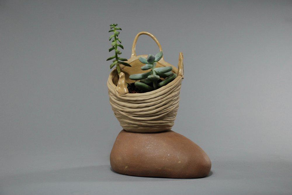 "clay, glaze, plants  9"" tall  2016"