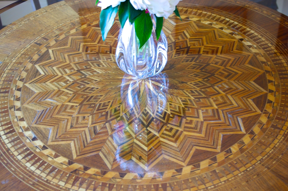 Ann's mother's antique table topped with new glass makes the perfect dining table in a small room