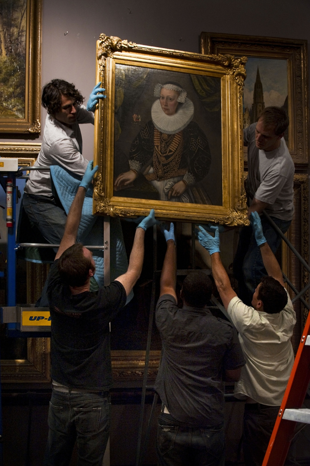 Exhibition technicians remove artwork from the California Gallery at the Crocker Art Museum in Sacramento on Thursday, June 10, 2010.
