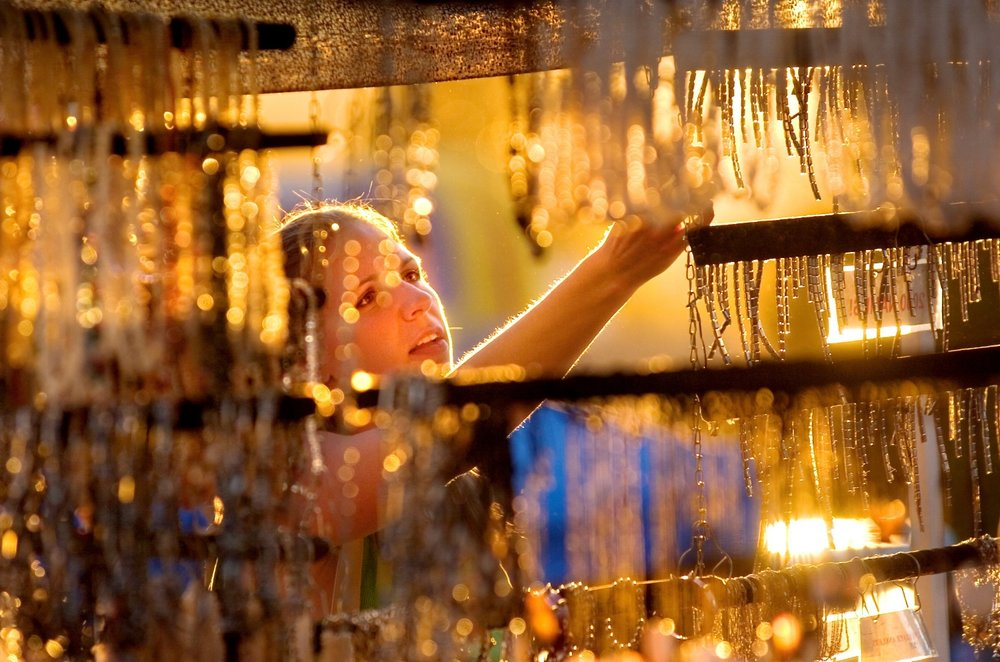Casey Long 21 of Seattle shops for jewelry at a booth at the Thursday Night Market in Folsom on Thursday July 7, 2005.