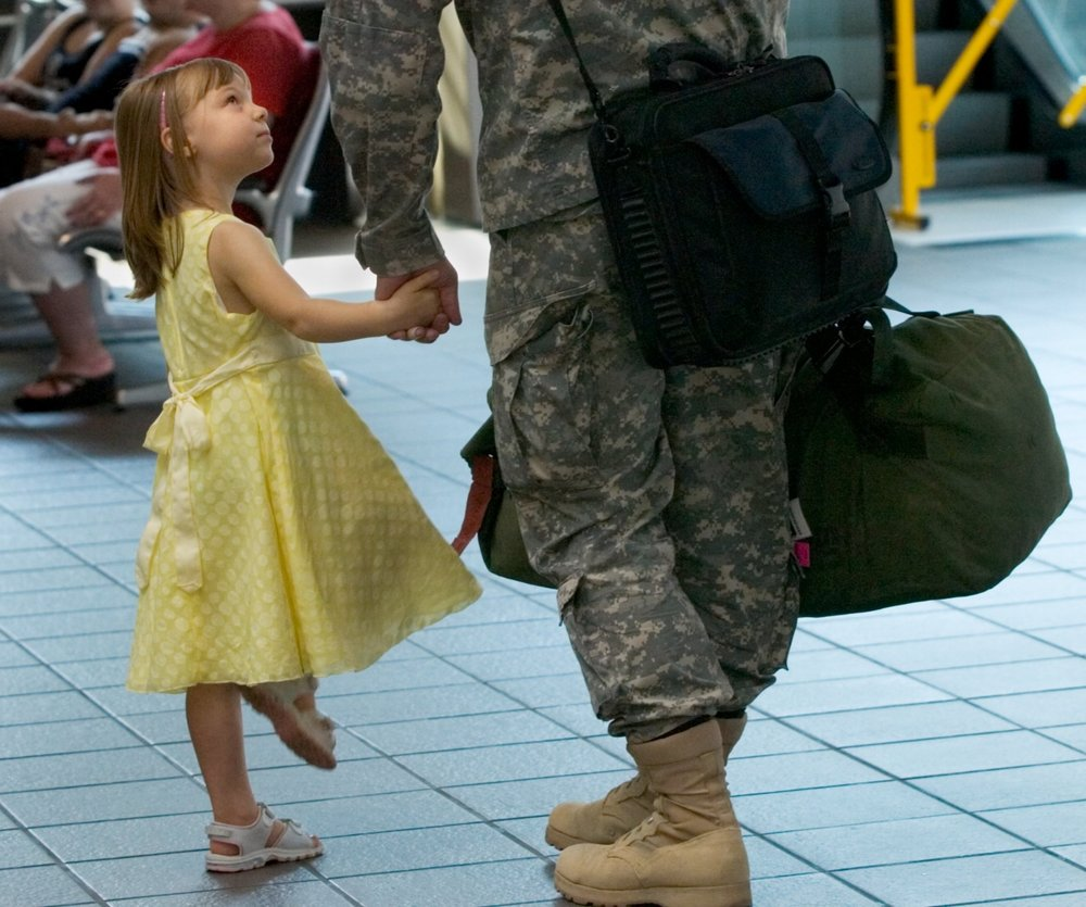 Brynne Keisler 4, left, prepares to leave the airport with her father Captain Mark Keisler of West Sacramento at the Sacramento International Airport on Wednesday September 13, 2006. Members of the California National Guard's 40th Corps Support Group returned from a tour of duty in Iraq
