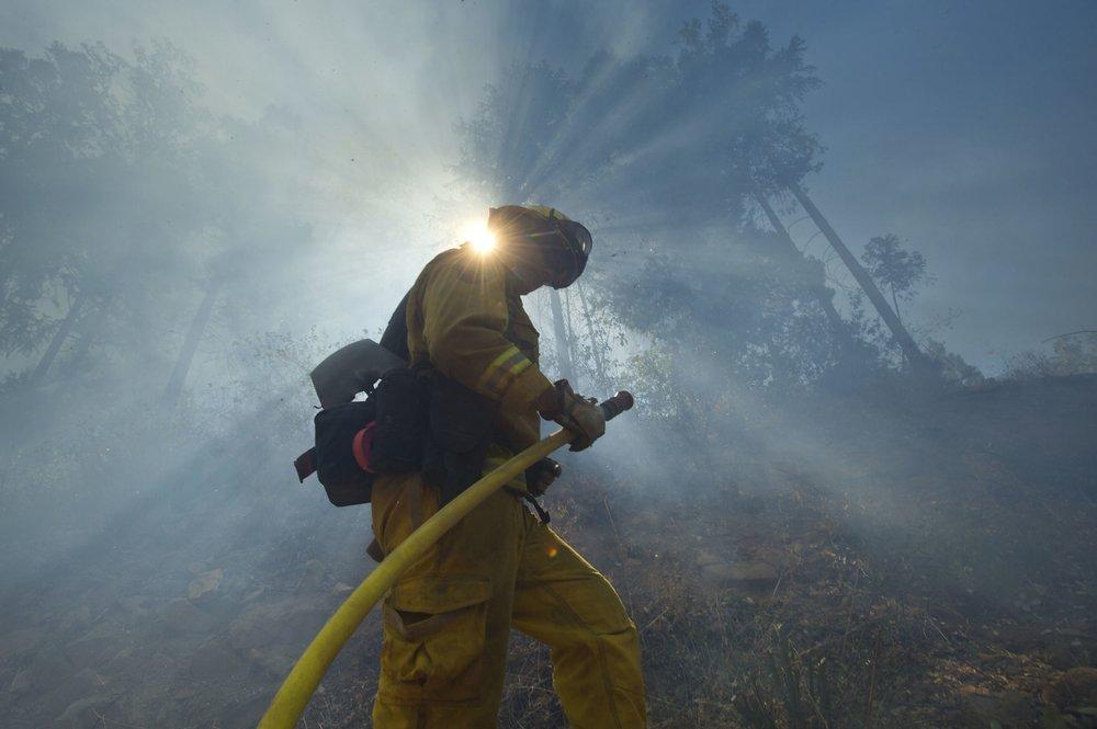 Cal Fire strike crews battle the King fire in El Dorado County near Fresh Pond on Wednesday, September 17, 2014.