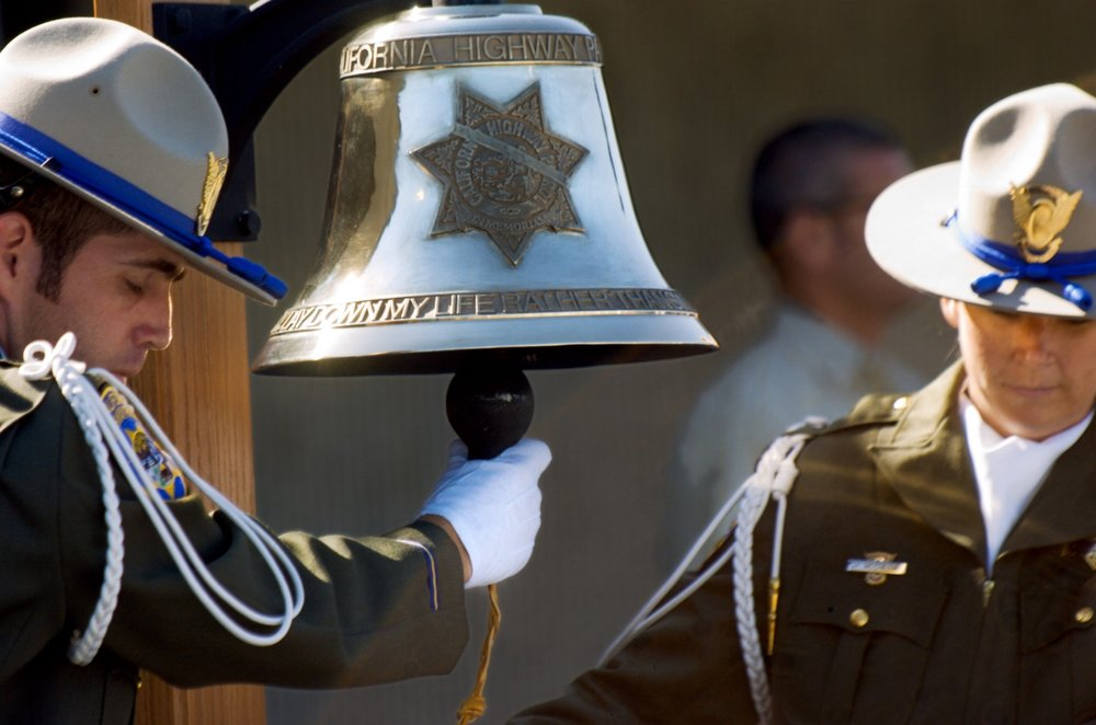 CHP Officers prepare to ring a bell during a ceremonial bell ringing at the CHP Academy in West Sacramento on Wednesday August 1, 2007. The ceremony was for Officer Douglas Russell who was killed in the line of duty in July.