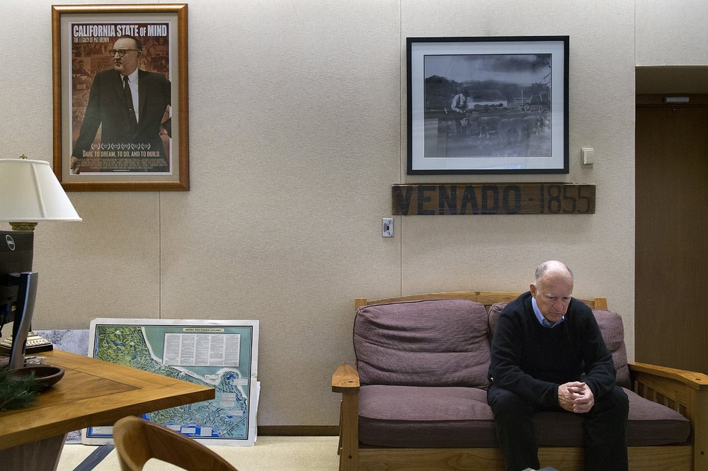 California Governor Jerry Brown sits in the governor's capitol office in Sacramento on Tuesday, December 1, 2015. Brown will be leaving for Paris France to participate in a global conference on climate change a few days later. As California's governor, climate change is one of his biggest issues.