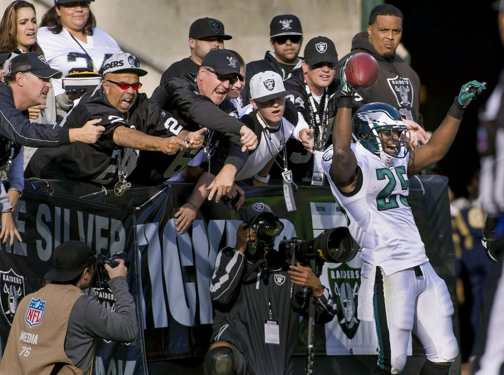 Raiders fans jeer as Eagles running back LeSean McCoy (25) celebrates a touchdown during the game between the Oakland Raiders and the Philadelphia Eagles at O.co Coliseum in Oakland on Sunday, November 3, 2013.