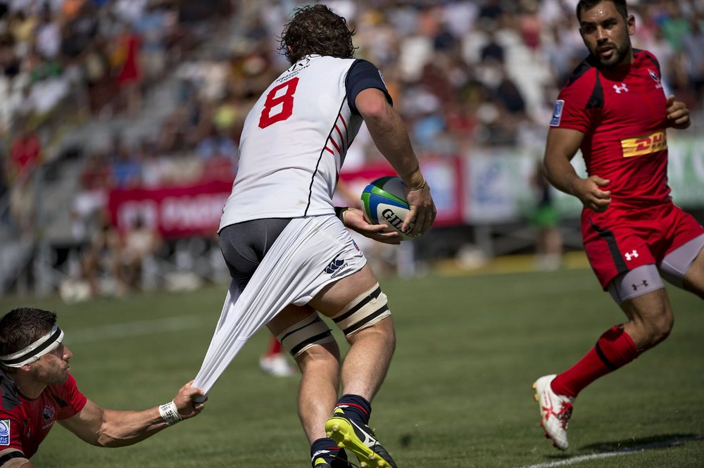 Men's Eagles Danny Barrett (8) is nearly tackled by Rugby Canada James Pritchard (15), left, during a rugby match between the USA Men's Eagles and Rugby Canada at Bonney Field in Sacramento on Saturday, June 21, 2014.