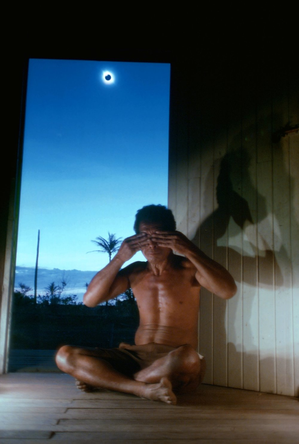 Alu Vali covers his eyes during a total solar eclipse in Hula, Papua New Guinea on November 22, 1984. The Papuan government distributed leaflets warning remote villagers of the risks of looking directly at the sun. Although it would have been safe look during the total phase, Vali was unwilling to look. The total eclipse lasted only 51 seconds here.