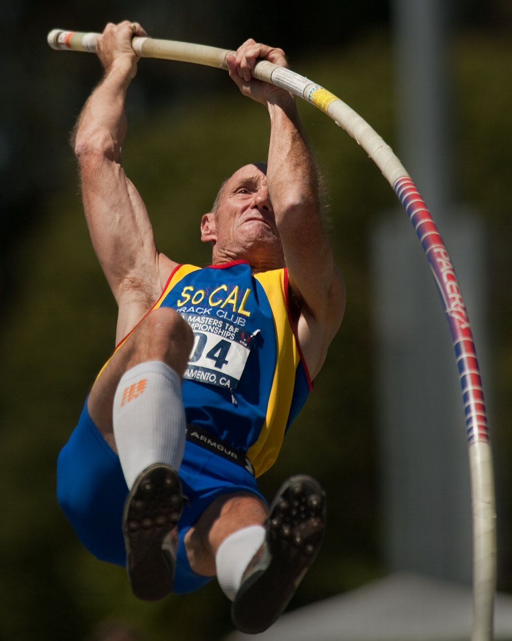 "Kirk Bentz 55 competes in the pole vault during the Masters Track and Field championship at Sac State in Sacramento on Saturday, July 24, 2010. Bentz finished second with a vault of 12' 11.5""."