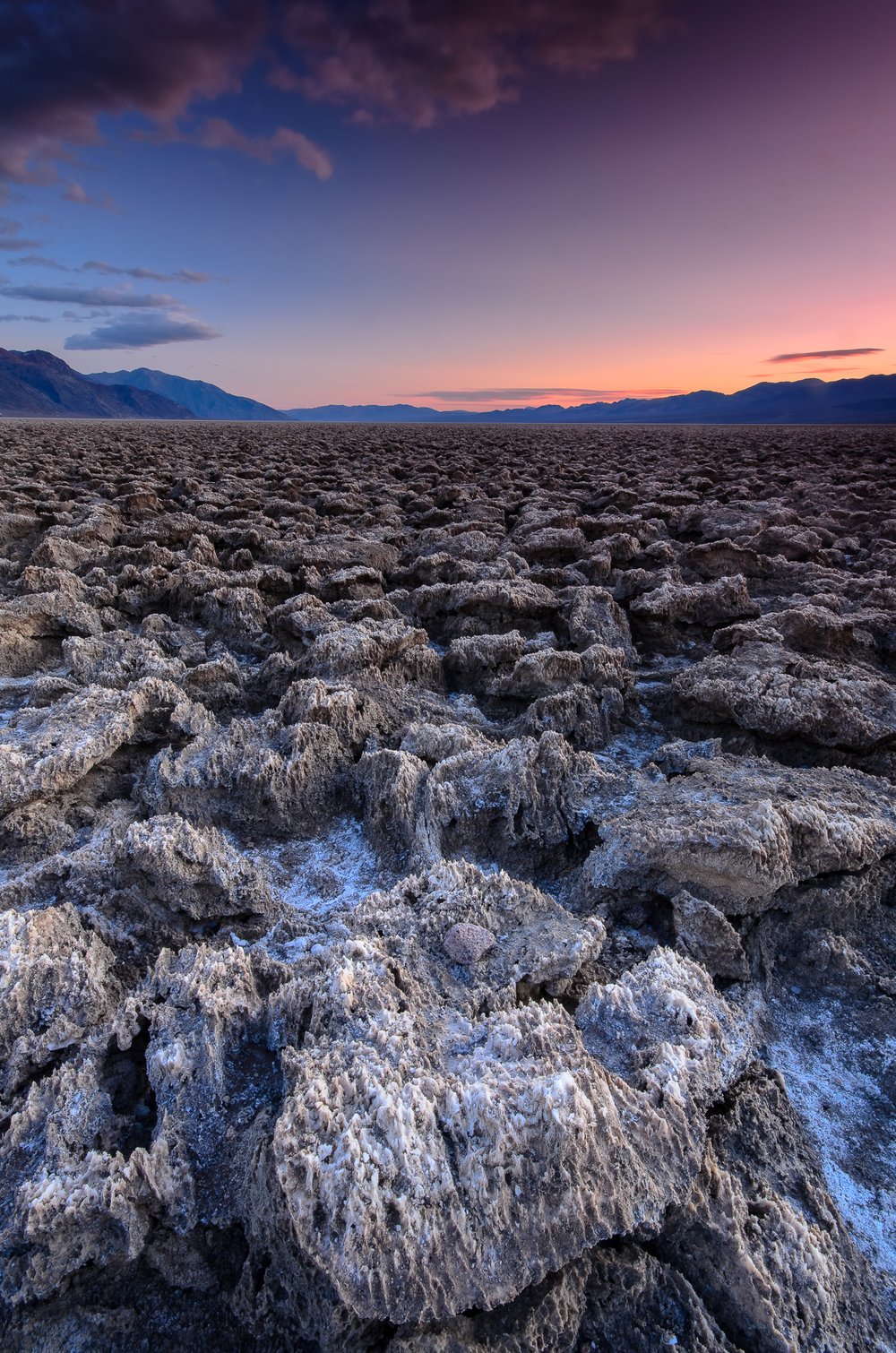 Twilight and blue hour take over and reveal the alien landscape of Devil's Golf Course in Death Valley, CA.