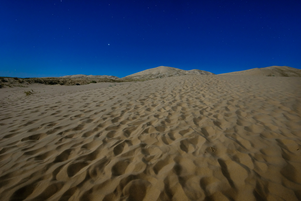 A full moon and ALLLL the footprints.  Kelso Dunes - Mojave, CA.