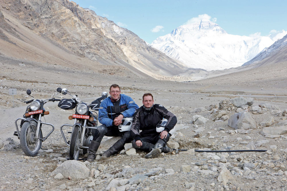 In my spare time I like going to cool places on my motorbike. This is me and my mate Mark at Everest base camp.