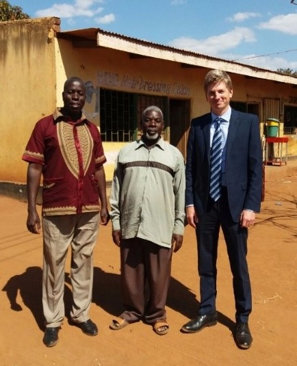 Huw in Katantha Village, Tsabango, Malawi, with village chieftains interested in adopting our service for their communities.