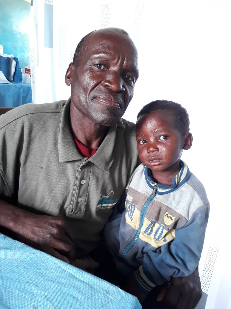 Patient's father happy to consent to virtual consultation for his daughter - Luyaba Rural Health Centre, Zimba.