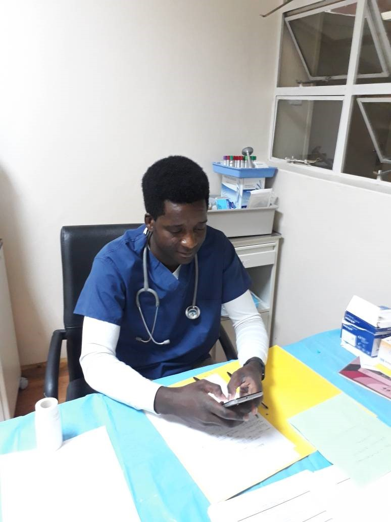 Akende Sikota Wina leaving feedback on an earlier virtual consultation during his night shift - Kalomo District Hospital..