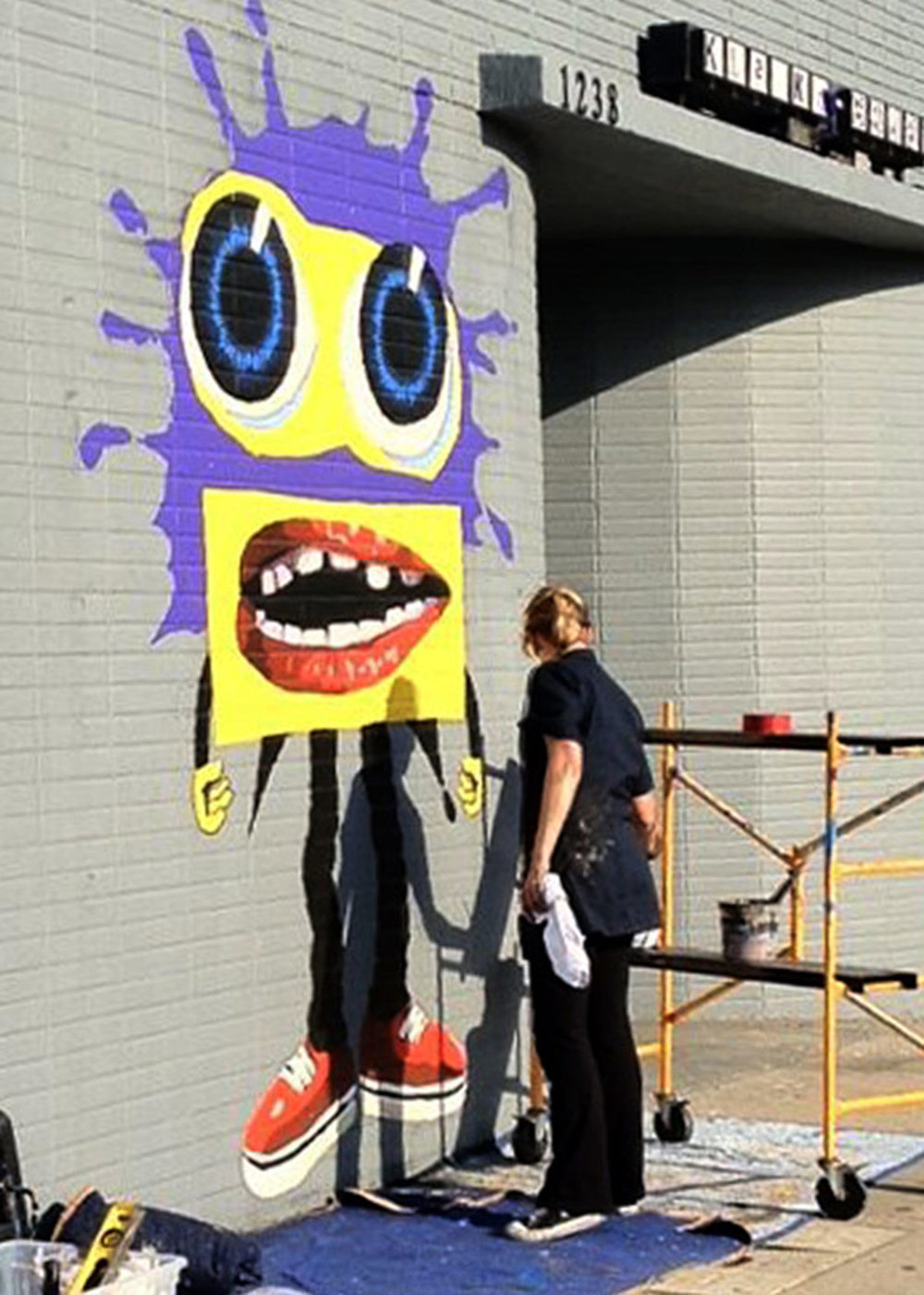 Jeanine painting Splaat on facade of Klasky Csupo Animation Studio.