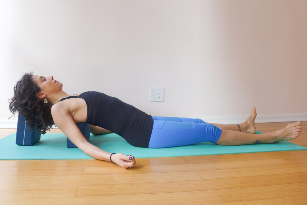 5. SUPPORTED FISH POSE (OR SUBSTITUTE SUPPORTED BRIDGE WITH ONE BLOCK UNDER YOUR SACRUM)