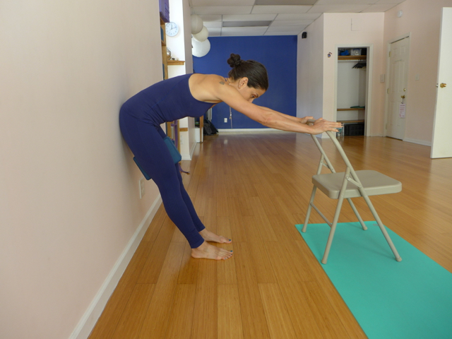 2. FORWARD BEND WITH SITTING BONES AT THE WALL