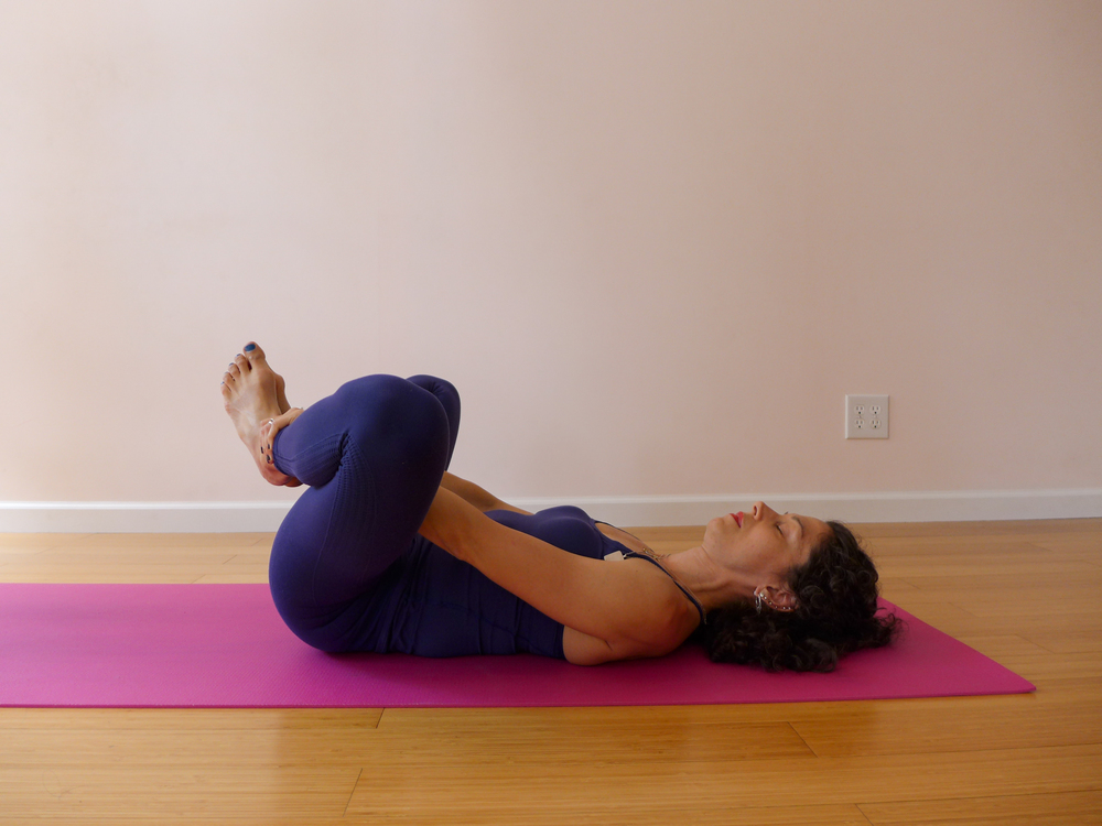 5. BOUND ANGLE POSE ON THE BACK
