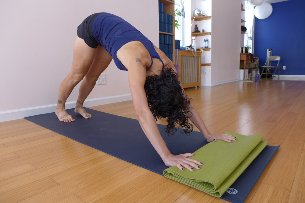 Down dog, alternate hand placement:  This is a good version if you have a hard time getting your hands to the ground.  Fold up a second yoga mat and place your fingertips and knuckles on it.  Press down into the folded up mat, draw your armbones into the sockets, and wrap the shoulder blades to the sides of your ribcage.