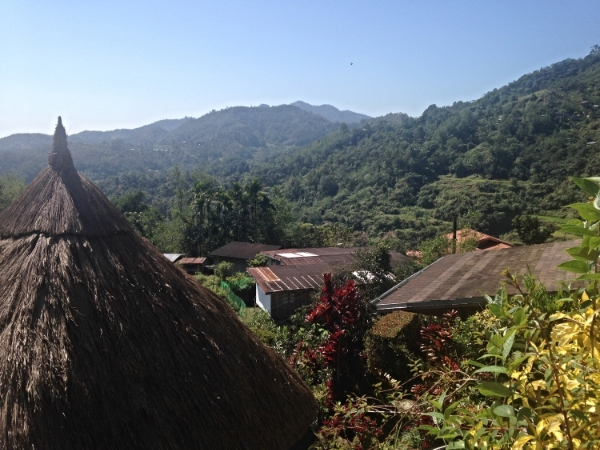 A traditional Ifugao home in the foreground of this Banaue skyline
