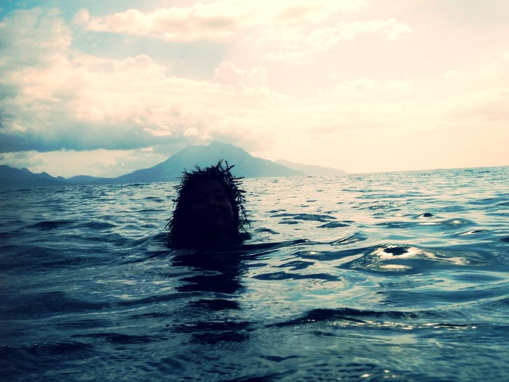 Mermaid girl in a seaweed crown
