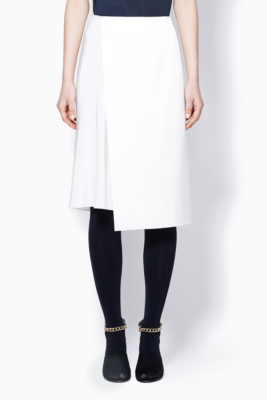 PL asymmetric overlay skirt with soft drape underlayer