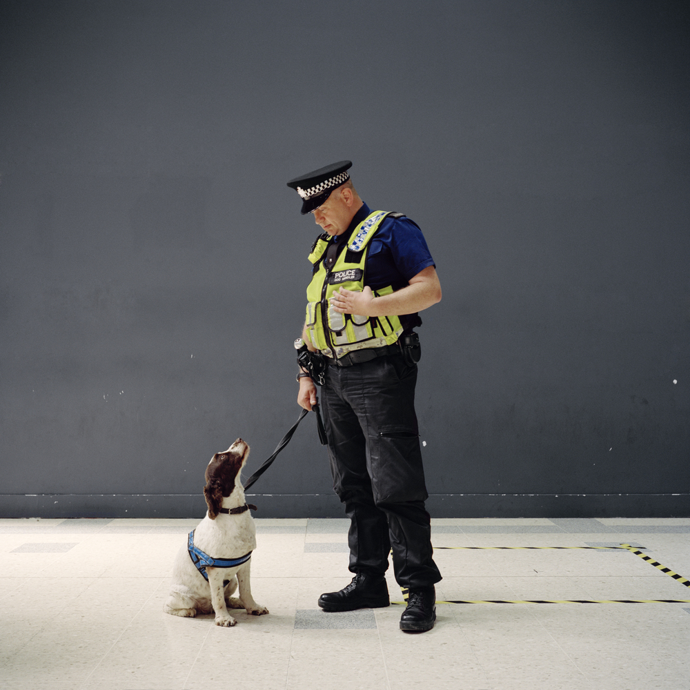 Police man and his sniffer dog, Waterloo, London