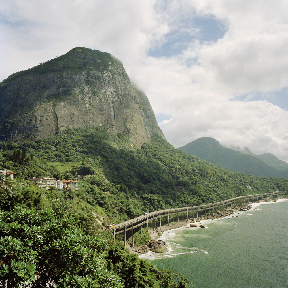 View of the Pedra da Gavea mountain from the Joatinga neighborhood, with the Elevado Das Bandeiras highway below.