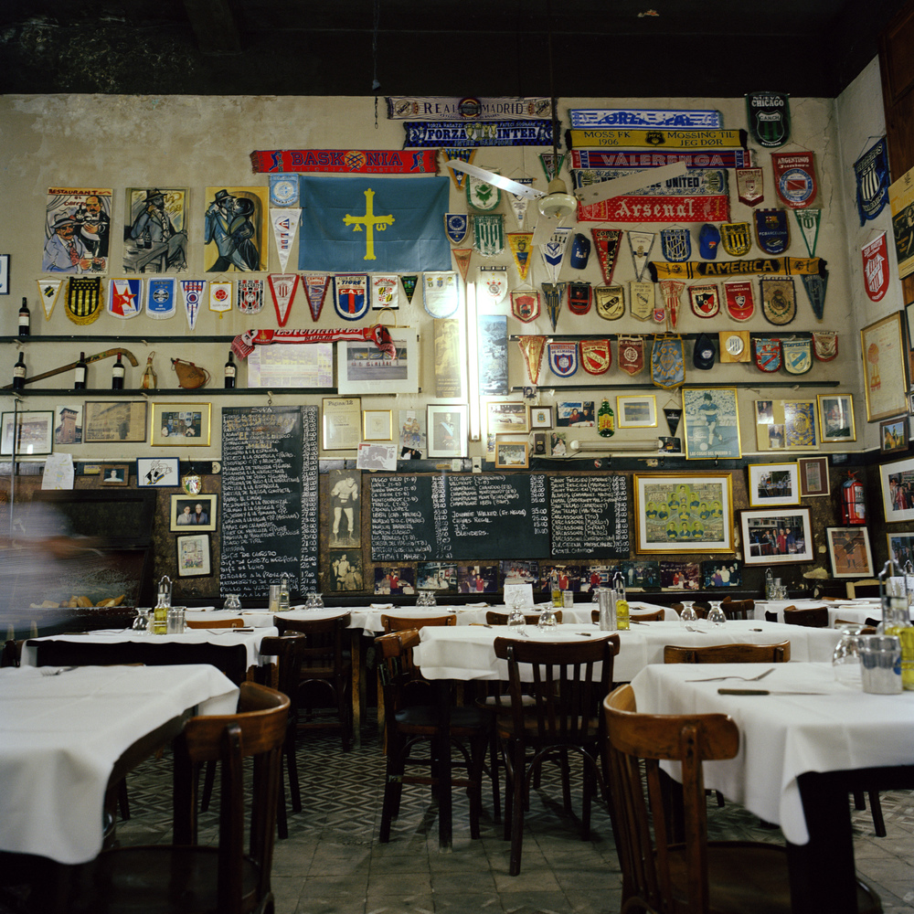 La Boca neighbourhood. El Obrero Restaurant. Walls decorated with football memorabilia.