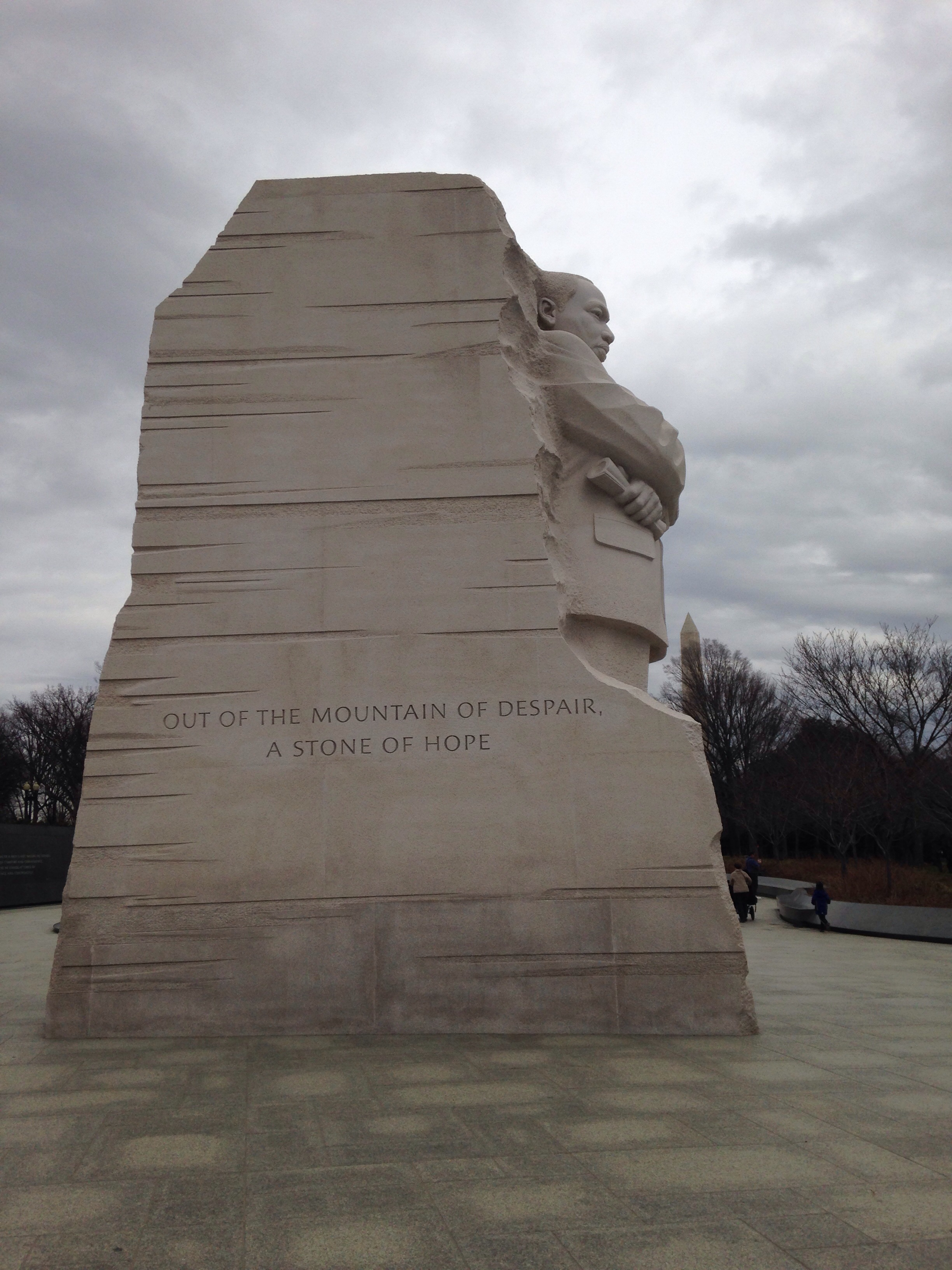 A side view of the memorial. Behind the doctor king statue, stand two sides of a mountain.