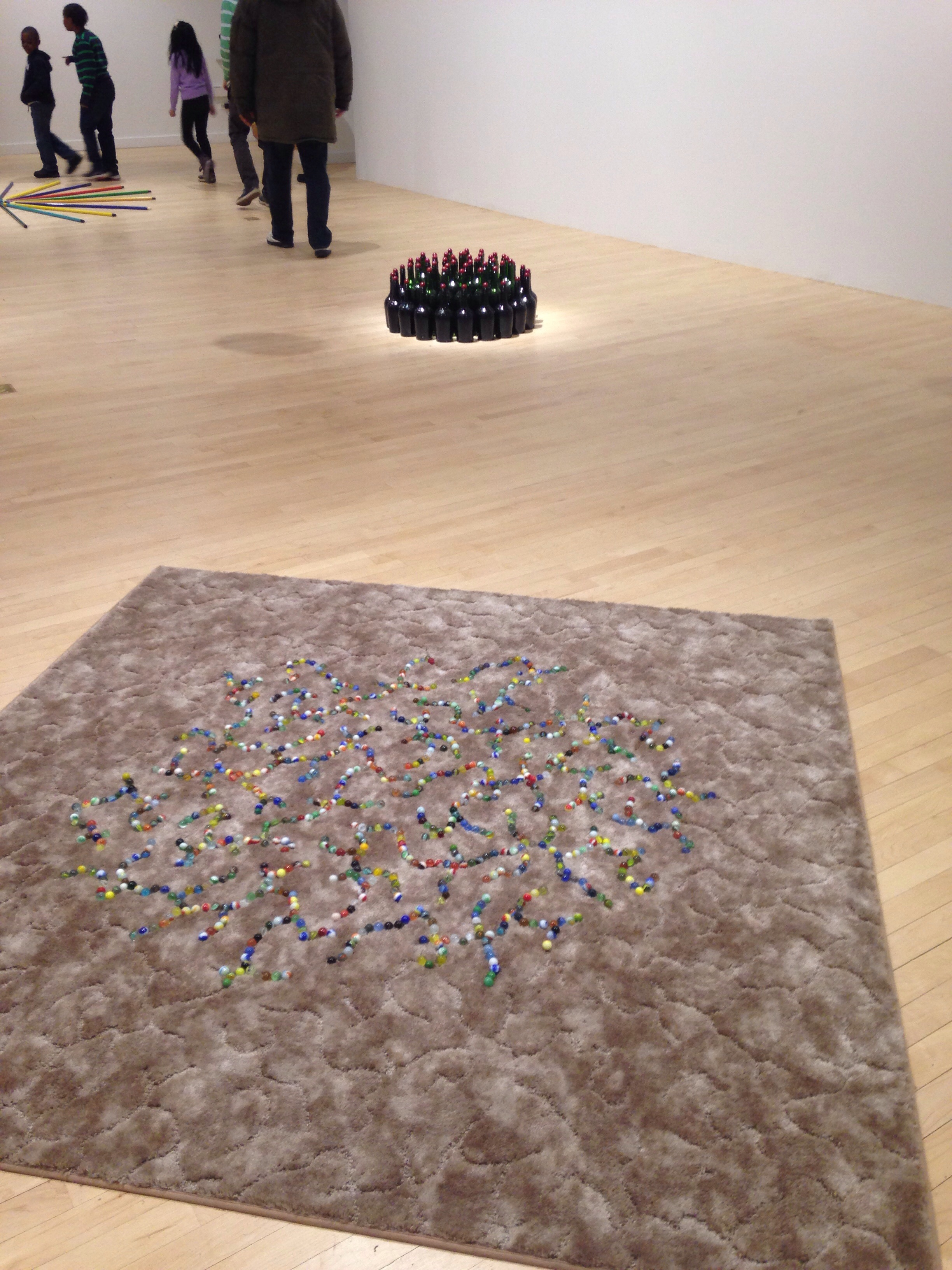 A plush carpet with marbles set in pattern.