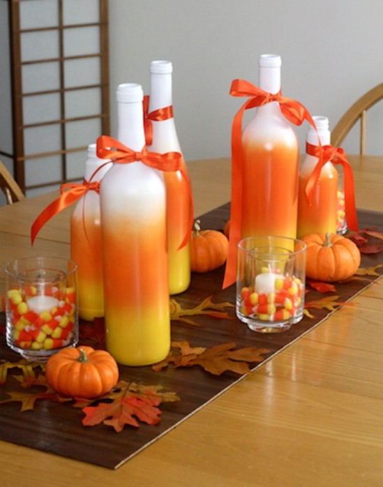 a classy candy corn centerpiece can be the perfect halloween touch to your dining area just spray paint candy corn colors yellow orange and white onto