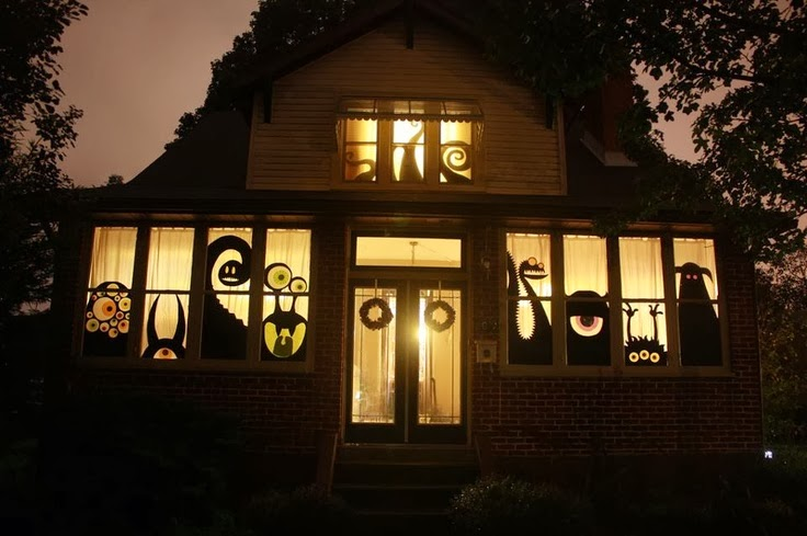 Maybe the house isn't a monster itself, but there are a bunch of monsters within ... like in this house that has a bunch of monster cutouts in the window to welcome visitors.