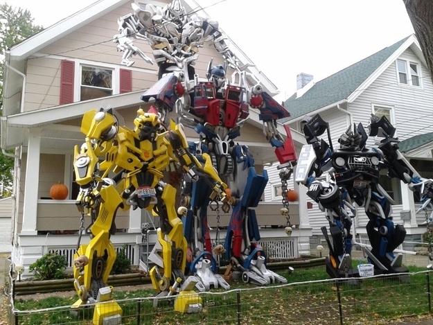 the whole transformers gang is there casually chilling in front of this suburban house and holding skulls on chains it doesnt get more badass than that