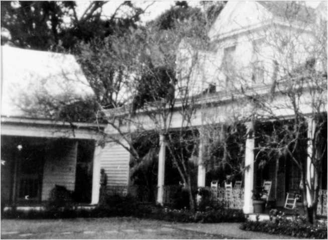 It all started with a photograph ... In 1992, the proprietress of the Myrtles photographed what appeared to be a slave girl standing between two of the buildings on the plantation.