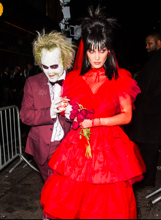 The Weeknd and Bella Hadid as Beetlejuice and Lydia.