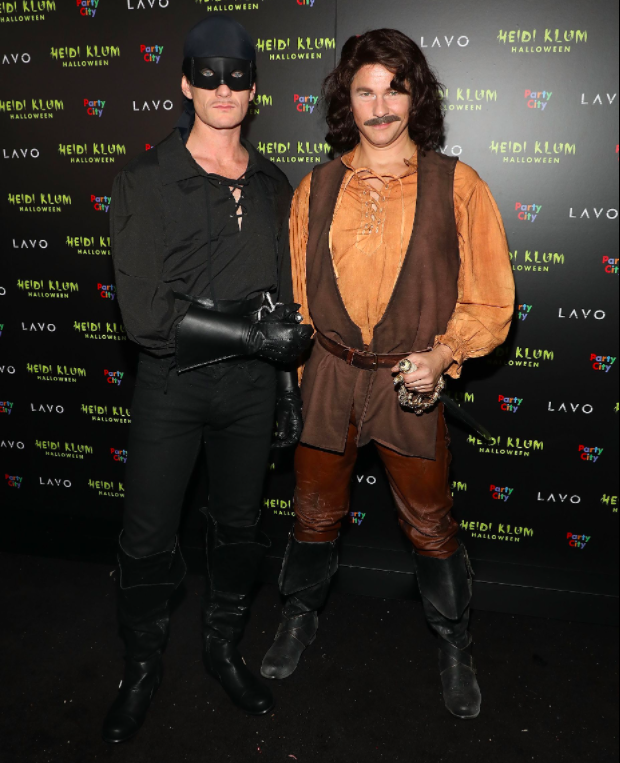 Neil Patrick Harris and David Burtka as Westley and Inigo Montoya from  The Princess Bride.
