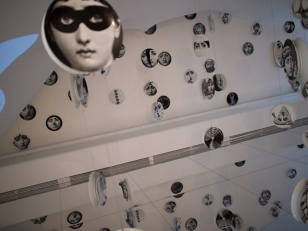 the trippiest section of the fantastic and large Fornasetti exhibit (on through June 14, 2015) with plates suspended from the ceiling and a mirrored floor. Musée des Arts Décoratifs.