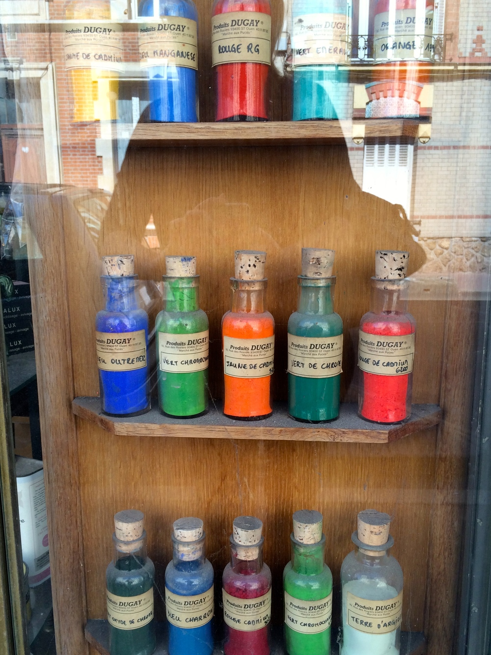 pigments in the window of a furniture restorer's shop, St. Ouen