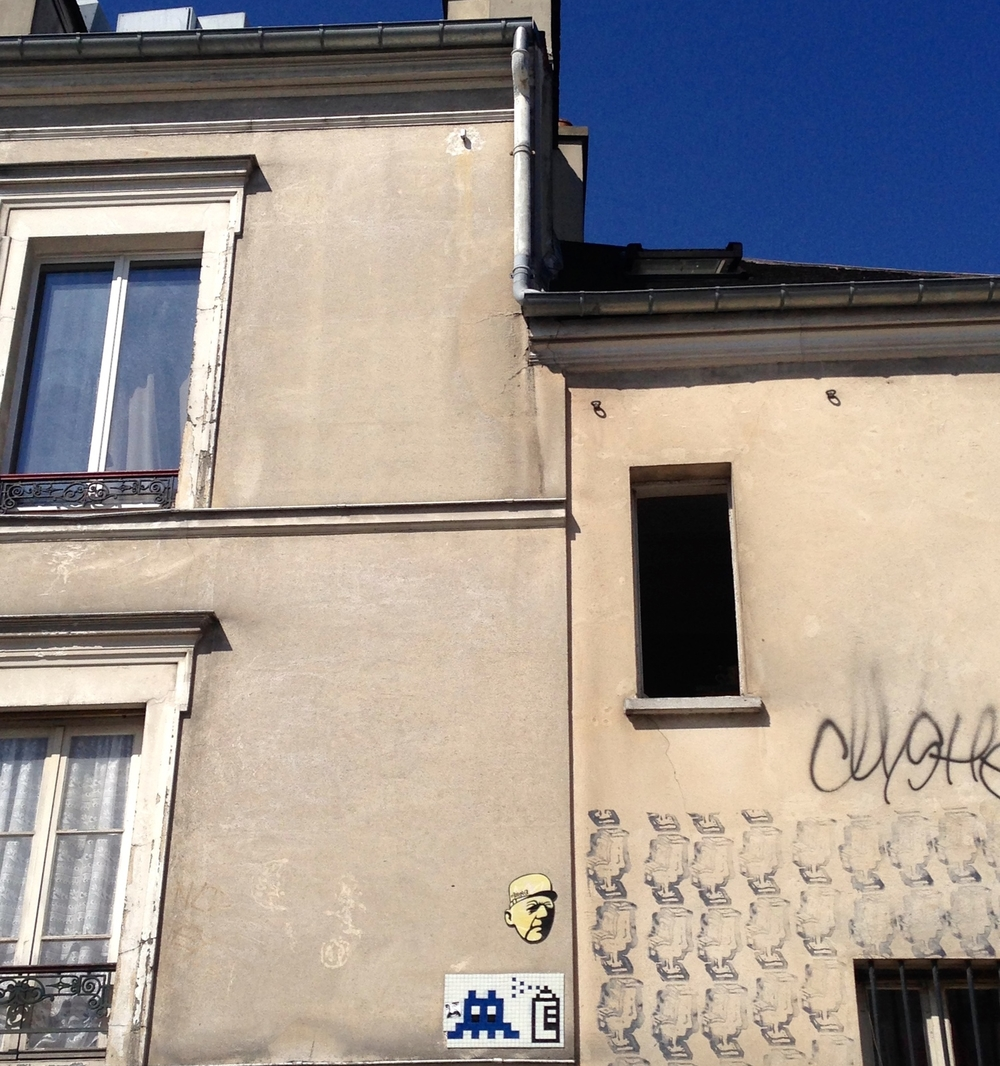Space Invaders are found throughout Paris, and it's fun to look for them. Graffiti, Montmarte