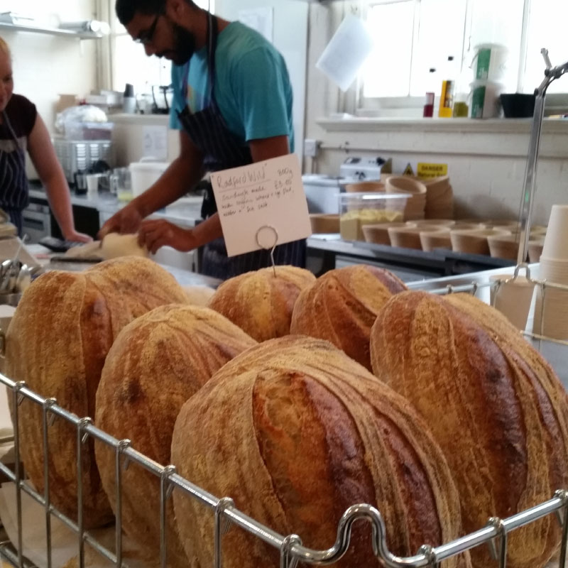 SMALL FOOD BAKERY / NOTTINGHAM Craft bakery selling handmade sourdough loaves, pizzas, crisp breads, cakes and pastries, located in a former primary school now used as an art gallery and artists' studios