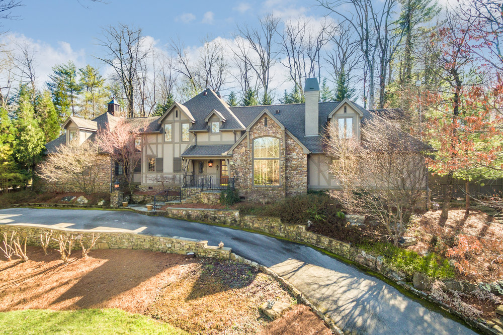 This stately French Country home is perched perfectly on the hill and is filled with custom details and features that you just have to see. A work of art on the inside and outside.