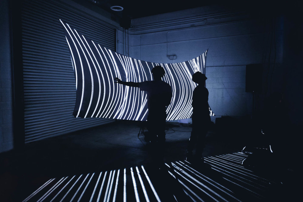 HALATION: exploring light & shadow - An exhibition creating a sense of place with light featuring immersive light environments by Marpi, Christopher Schardt & Ecco Screen.