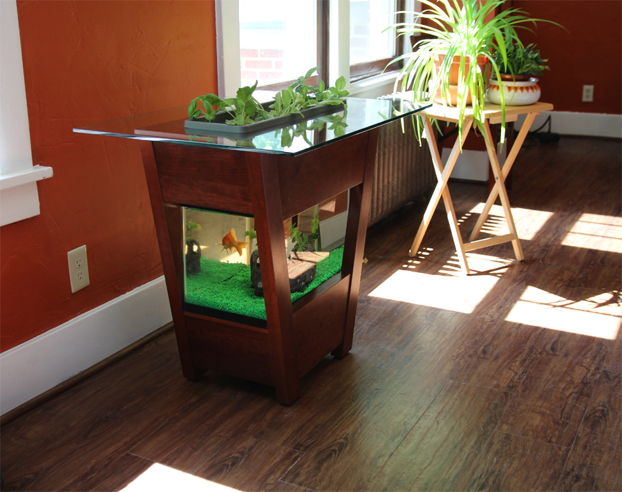 - Using the aerobic nitrogen cycle, Living Furniture integrates a self-cleaning aquarium with a self-maintaining indoor garden, creating a sustaining standalone furniture piece. Ideal for individuals or businesses that want to express and appreciate the cultivation of nature. Standard products and custom designs are available.