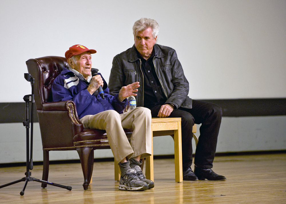 Louis Zamperini and son, Luke Zamperini, answer questions during resilience training at Edwards Airforce Base. Photo by U.S. Airforce.