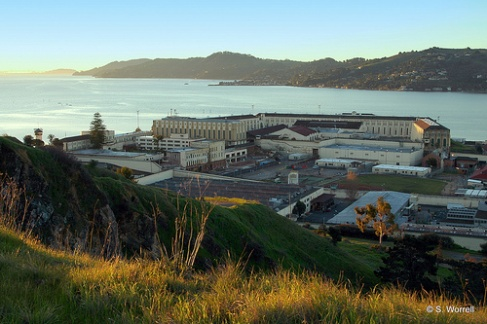 The sun creeps up over the walls of San Quentin Prison