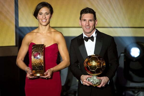 Carli Lloyd and Lionel Messi clutch some FIFA hardware (photo by  Philipp Schmidli)
